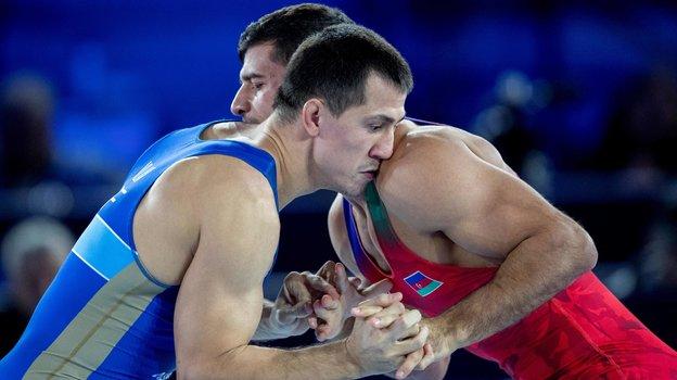 Роман Власов (слева). Фото AFP