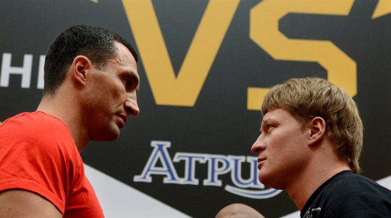 Владимир КЛИЧКО (слева) и Александр ПОВЕТКИН. Фото AFP.