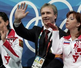 Яна ХОХЛОВА, Александр СВИНИН (в центре) и Сергей НОВИЦКИЙ. Фото AFP Фото «СЭ»