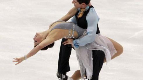 Олимпийские чемпионы в танцах на льду Тесса ВИРТУ и Скотт МОИР. Фото Reuters