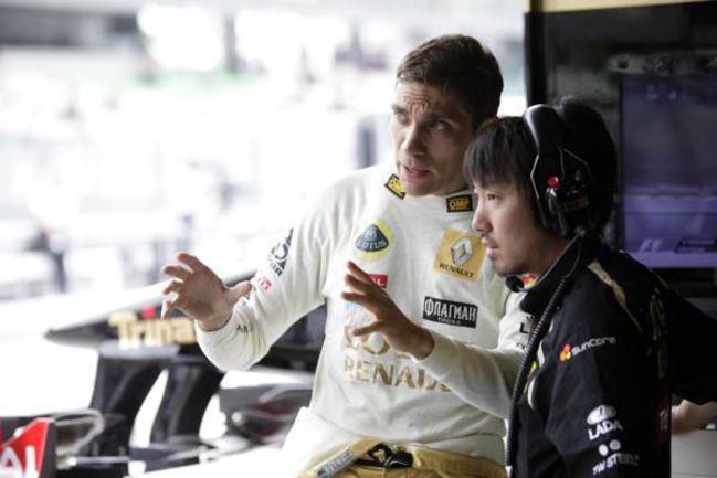 """Виталий ПЕТРОВ и Айо КОМАЦУ. Фото Lotus Renault GP Фото """"СЭ"""""""