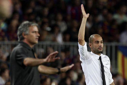 "Вчера. Барселона. ""Барселона"" - ""Реал"" - 3:2. Хосеп ГВАРДЬОЛА (справа) и Жозе МОУРИНЬЮ. Фото REUTERS"