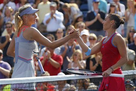 Суббота. Нью-Йорк. Мария ШАРАПОВА (слева) потерпела поражение от Флавии ПЕННЕТТЫ, допустив 60 невынужденных ошибок. Фото REUTERS
