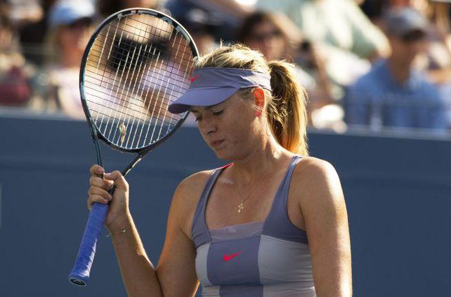 Мария ШАРАПОВА покидает US Open-2011. Фото AFP