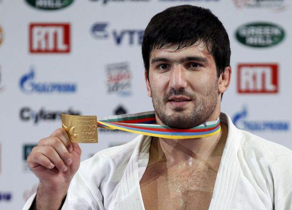 Тагир ХАЙБУЛАЕВ выиграл в Париже первое в истории российское золото чемпионата мира в категории до 100 кг. Фото REUTERS