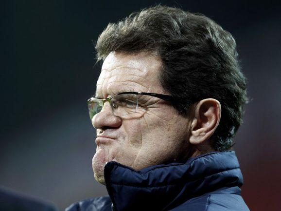 Экс-главный тренер сборной Англии Фабио КАПЕЛЛО в ближайшем будущем может возглавить нашу национальную команду. . Фото REUTERS