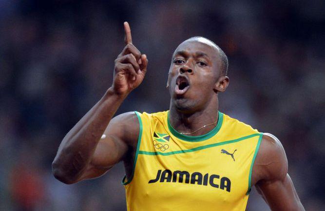 Вчера. Лондон. Усэйн БОЛТ устанавливает новый олимпийский рекорд. Фото AFP