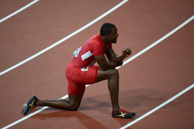Воскресенье. Лондон. Бронзовый призер Игр в беге на 100 метров Джастин ГЭТЛИН после финального забега. Фото AFP