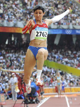 Пекин-2008. 17 и 22 августа. Татьяна ЛЕБЕДЕВА - серебряный призер Олимпиады в тройном прыжке с результатом 15,32 и серебряный призер в прыжках в длину с результатом 7,03. Фото AFP
