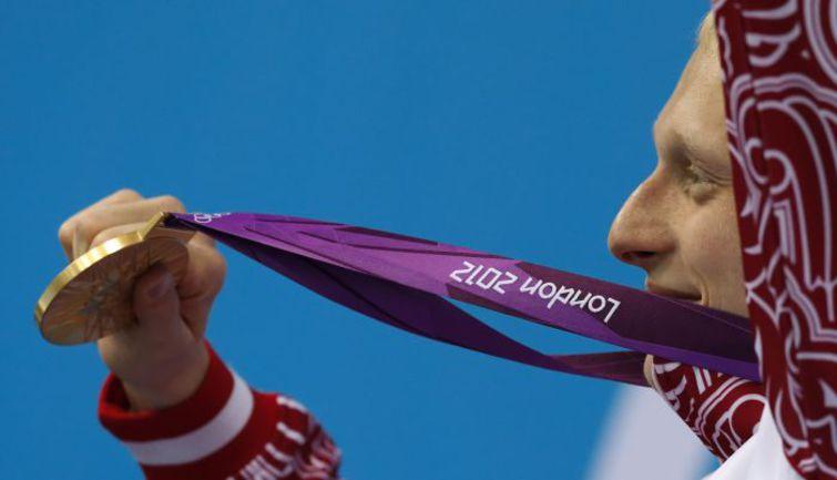 Вторник. Лондон. Олимпийский чемпион в прыжках с 3-метрового трамплина Илья ЗАХАРОВ. Фото REUTERS