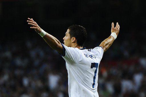 """Среда. Мадрид. """"Сантьяго Бернабеу"""". """"Реал"""" - """"Барселона"""" - 2:1. КРИШТИАНУ РОНАЛДУ празднует гол, который станет для его команды победным. Фото AFP"""
