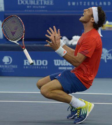 Воскресенье. Аргентинец Хуан МОНАКО - победитель турнира в Куала-Лумпуре. Фото AFP