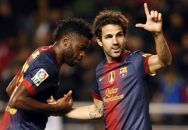 """Суббота. Мадрид. """"Райо Вальекано"""" - """"Барселона"""" - 0:5. Игроки гостей Алекс СОНГ (слева) и Сеск ФАБРЕГАС. Фото REUTERS"""