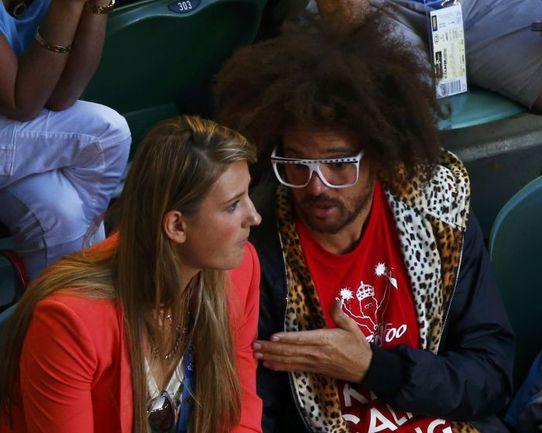 Вчера. Виктория АЗАРЕНКО и певец РЕДФУ на мужском финале. Фото Reuters