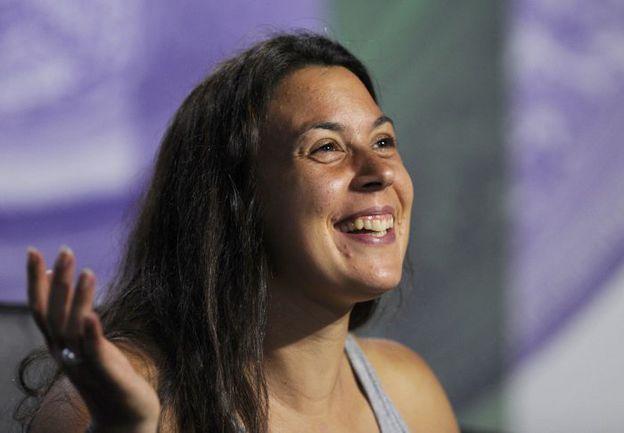 Суббота. Лондон. На чемпионской пресс-конференции Марион БАРТОЛИ светилась от счастья. Фото Reuters