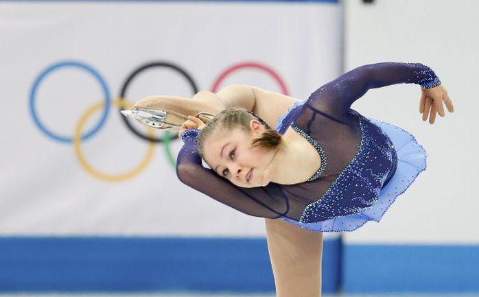 Сегодня. Сочи. Юлия ЛИПНИЦКАЯ выполняет короткую программу в командных соревнованиях. Фото REUTERS