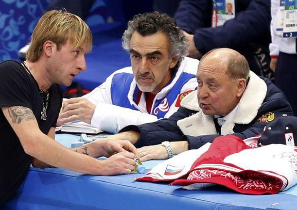 Двукратный олимпийский чемпион Евгений ПЛЮЩЕНКО (слева) и его тренер Алексей МИШИН (справа). Фото REUTERS