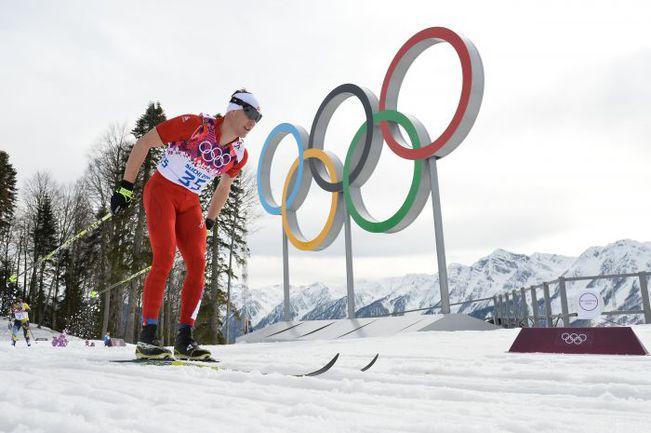 Швейцарский лыжник Дарио КОЛОНЬЯ. Фото AFP