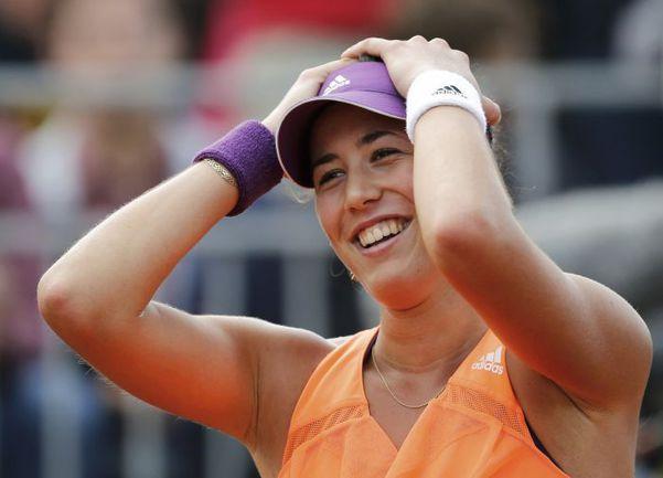 На нынешнем Roland Garros 35-я ракетка мира Гарбине МУГУРУСА не проиграла пока ни одного сета, что позволило ей, как и на Australian Open, дойти до 1/8 финала. Фото REUTERS