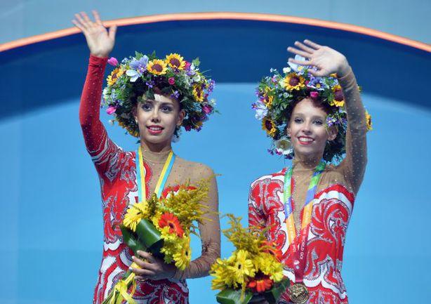 Российские гимнастки Яна КУДРЯВЦЕВА (справа) и Маргарита МАМУН. Фото AFP