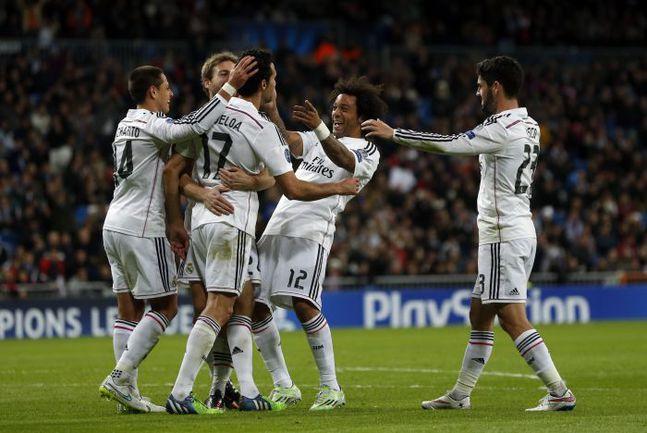 """Вторник. Мадрид. """"Реал"""" – """"Лудогорец"""" – 4:0. Альваро АРБЕЛОА (№17) празднует с партнерами гол. Фото REUTERS"""