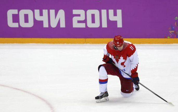 Печаль Евгения МАЛКИНА после поражения в матче с Финляндией. Фото REUTERS