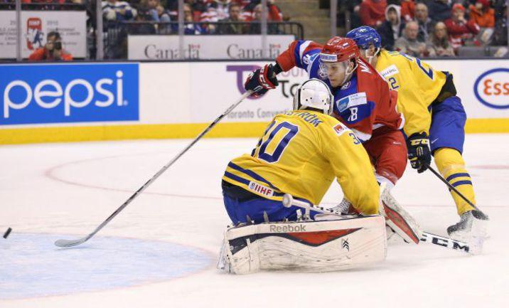 Сегодня. Торонто. Швеция - Россия - 1:4. Максим МАМИН ставит точку в матче. Фото AFP