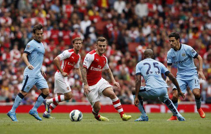 """В первом матче чемпионата-2014/15 """"Арсенал"""" и """"Манчестер Сити"""" сыграли в Лондоне вничью - 2:2. Фото AFP"""