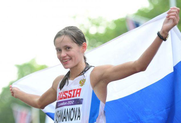 11 августа 2012 года. Лондон. Только что Елена ЛАШМАНОВА выиграла олимпийскую 20-километровую гонку. Фото AFP
