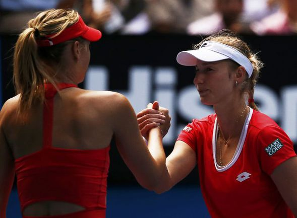 Сегодня. Мельбурн. Екатерина МАКАРОВА (справа) и Мария ШАРАПОВА после матча. Фото REUTERS