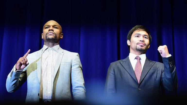 Флойд МЕЙУЭЗЕР (слева) и Мэнни ПАКИАО. Фото AFP