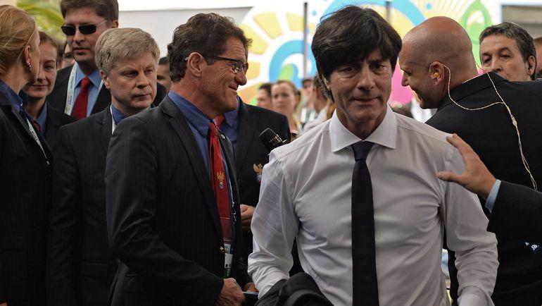 Главный тренер сборной России Фабио КАПЕЛЛО и его коллега из национальной команды Германии Йоахим ЛЕВ. Фото REUTERS
