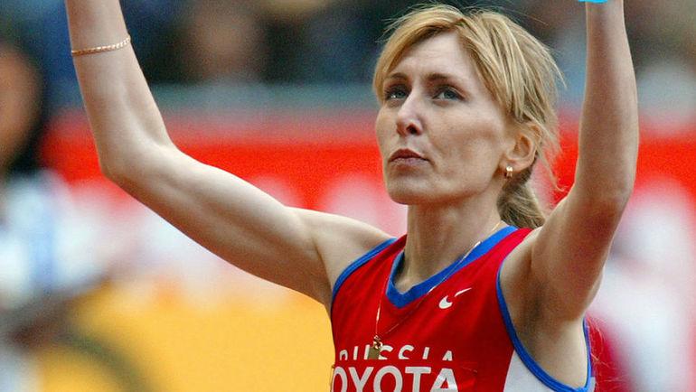 31 августа 2003 года. Париж. Татьяна ТОМАШОВА выигрывает забег на 1500 метров на чемпионате мира. Фото AFP