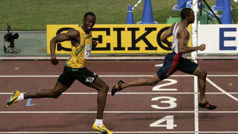 2007 год. Усэйн БОЛТ уступает Тайсону ГЭЮ на финише в Осаке. Фото REUTERS