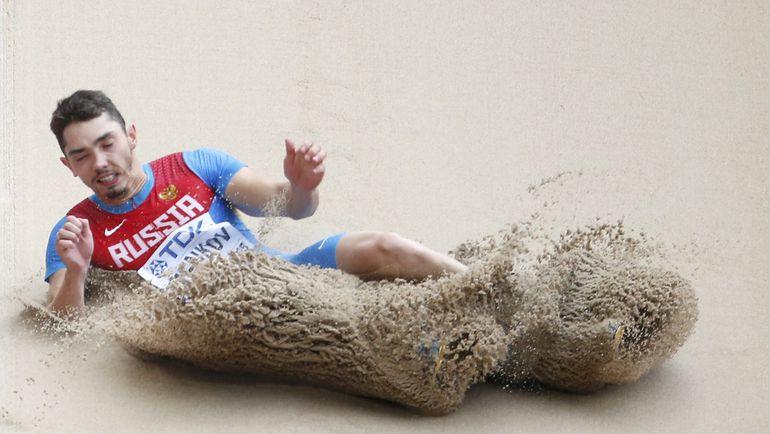 Понедельник. Пекин. Александр МЕНЬКОВ вышел в финал чемпионата мира с седьмым результатом в квалификации. Фото REUTERS