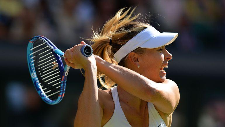 Мария ШАРАПОВА проиграла Серене Уильямс в финале Уимблдона-2015. Фото AFP