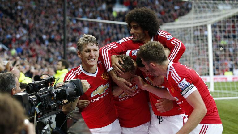 """Суббота. Манчестер, """"Манчестер Юнайтед"""" - """"Ливерпуль"""" - 3:1. Игроки """"МЮ"""" отмечают забитый гол. Фото Reuters"""