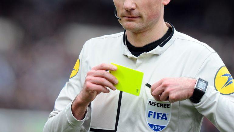 Желтая карточка. Фото AFP