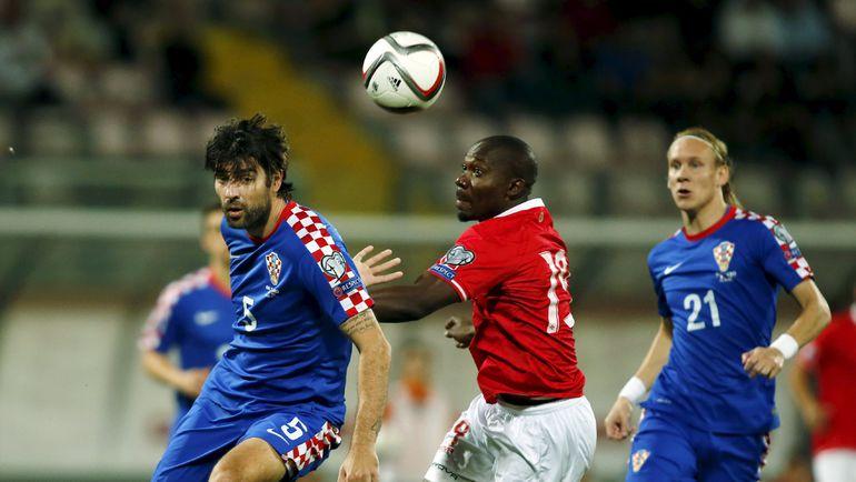 Ведран ЧОРЛУКА (слева) в решающем для сборной Хорватии матче отбора против Мальты. Фото REUTERS