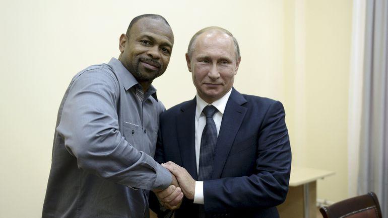 Рой ДЖОНС и президент России Владимир ПУТИН. Фото REUTERS
