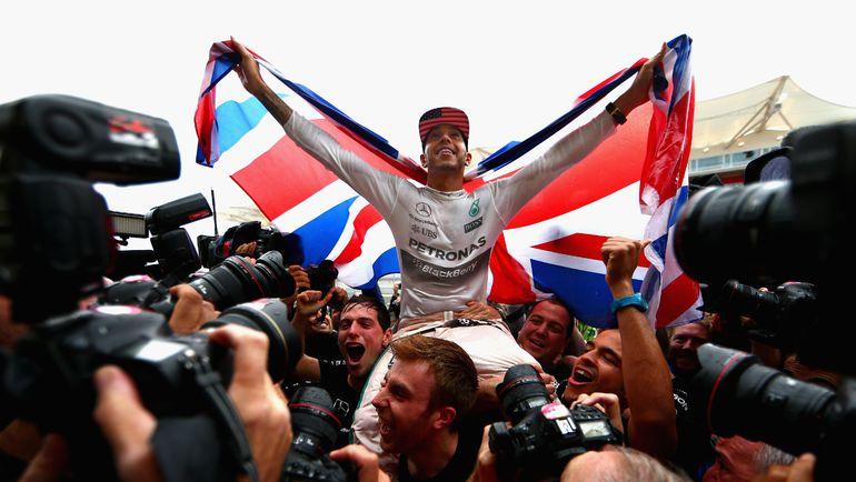 Воскресенье. Остин. Льюис ХЭМИЛТОН празднует третий чемпионский титул. Предыдущие два он завоевал в 2008 и 2014 годах. Фото AFP