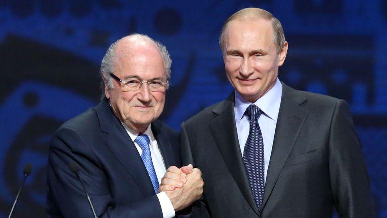 Йозеф БЛАТТЕР и президент России Владимир ПУТИН. Фото REUTERS