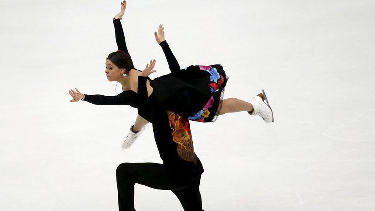 Сегодня. Пекин. Елена ИЛЬИНЫХ и Руслан ЖИГАНШИН исполняют произвольный танец. Фото REUTERS