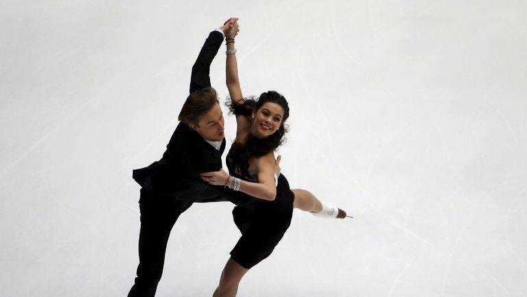 Вчера. Пекин. Елена ИЛЬИНЫХ и Руслан ЖИГАНШИН исполняют короткий танец. Фото REUTERS