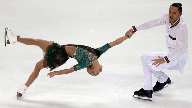 Татьяна ВОЛОСОЖАР и Максим ТРАНЬКОВ впервые в сезоне вышли на соревновательный лед. Фото REUTERS