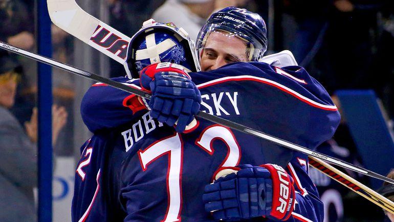 Сергей БОБРОВСКИЙ и Ник ФОЛИНЬО. Фото AFP
