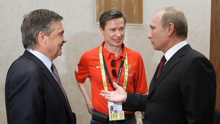 Рене ФАЗЕЛЬ, Вячеслав БЫКОВ и Владимир ПУТИН. Фото REUTERS