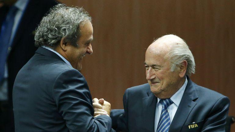 Глава УЕФА Мишель ПЛАТИНИ и президент ФИФА Зепп БЛАТТЕР. Фото REUTERS