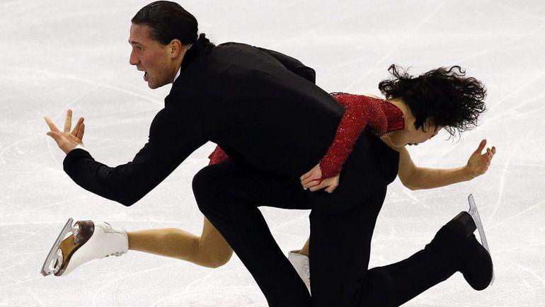 Вчера. Барселона. Юко КАВАГУТИ и Александр СМИРНОВ выступают в короткой программе. Фото Reuters