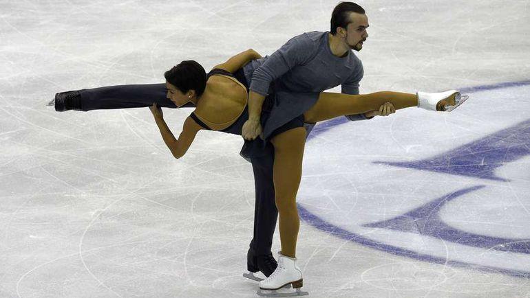 Вчера. Барселона. Ксения СТОЛБОВА и Федор КЛИМОВ исполняют произвольную программу. Фото AFP